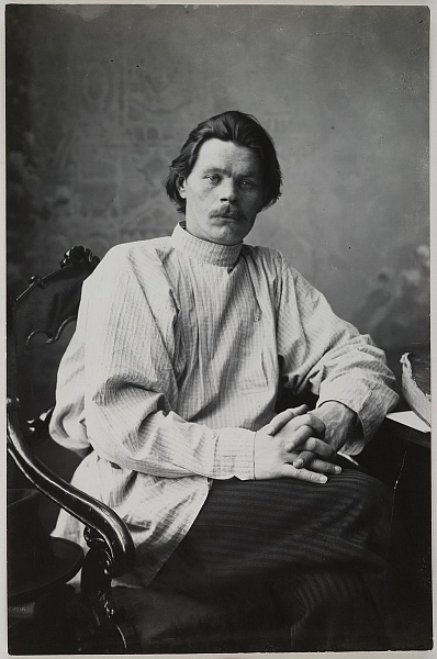 800px-Portrait_of_Maxim_Gorky_sitting_in_an_armchair_wearing_a_light_shirt._(14728267252).jpg